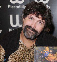 Wrestler and prolific author Mick Foley poses with one of his forthcoming autobiographies, Foley is Good Part 2: Foley is Gooder  (photo credit: WENN.com)